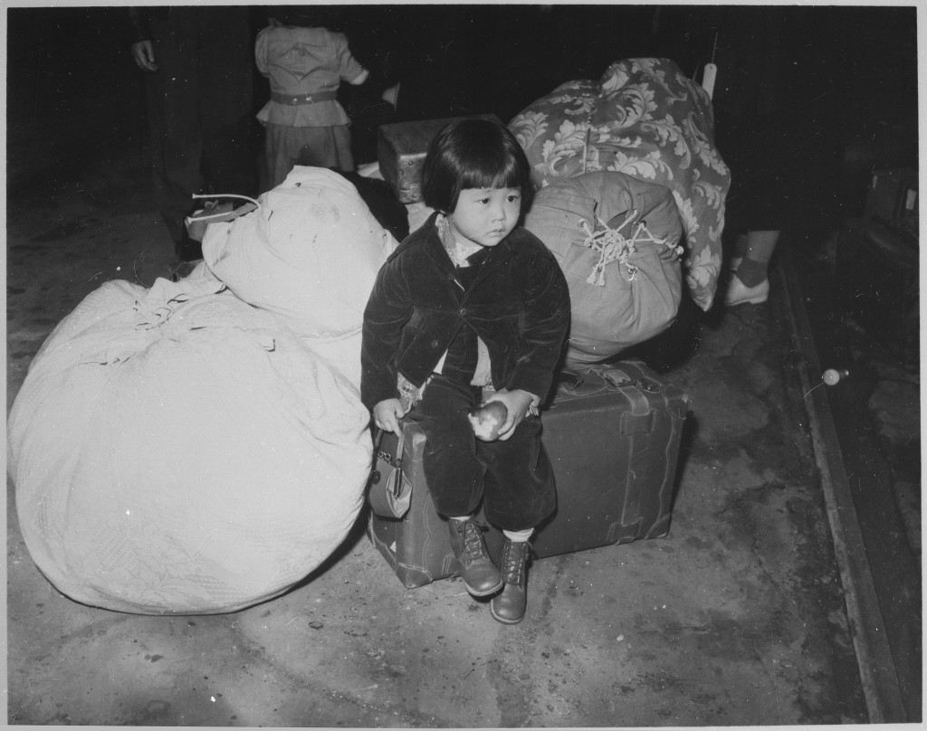 http://en.wikipedia.org/wiki/Internment_of_Japanese_Americans#mediaviewer/File:A_young_evacuee_of_Japanese_ancestry_waits_with_the_family_baggage_before_leaving_by_bus_for_an_assembly_center..._-_NARA_-_539959.jpg