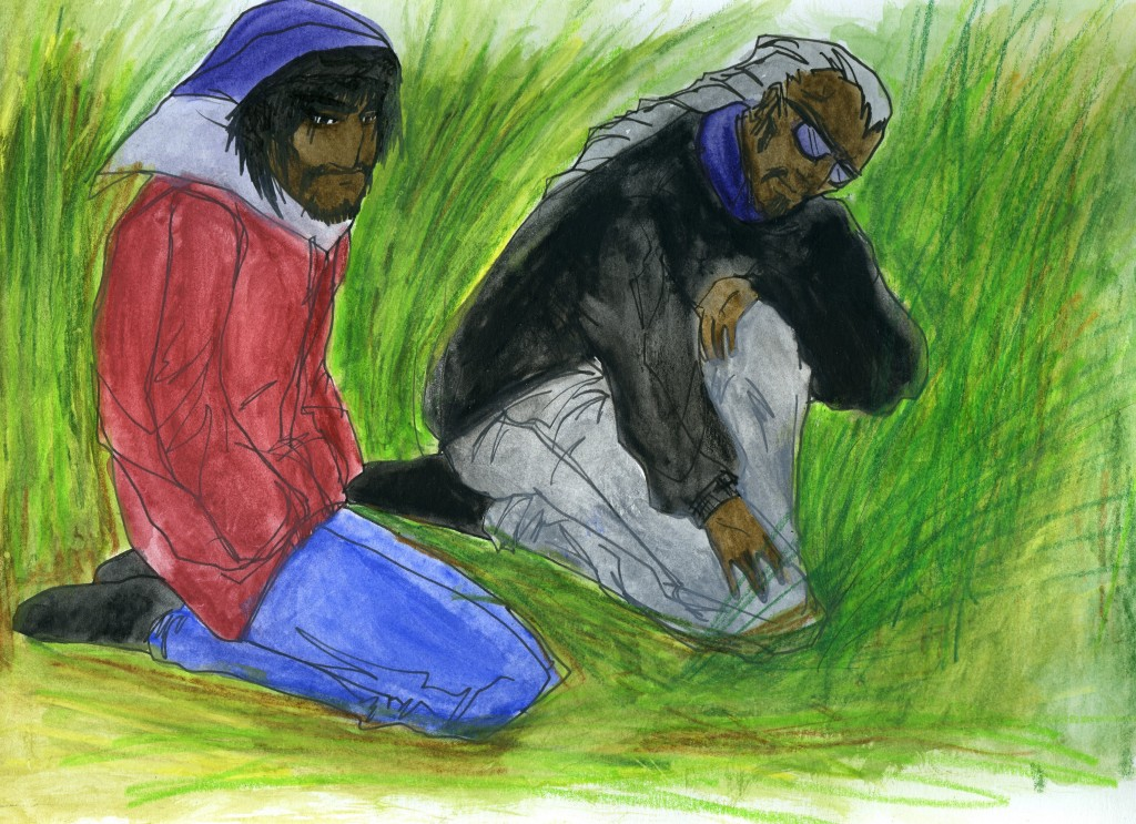 A teenager and a man kneel in tall grass. The man reaches down and touches the grass.