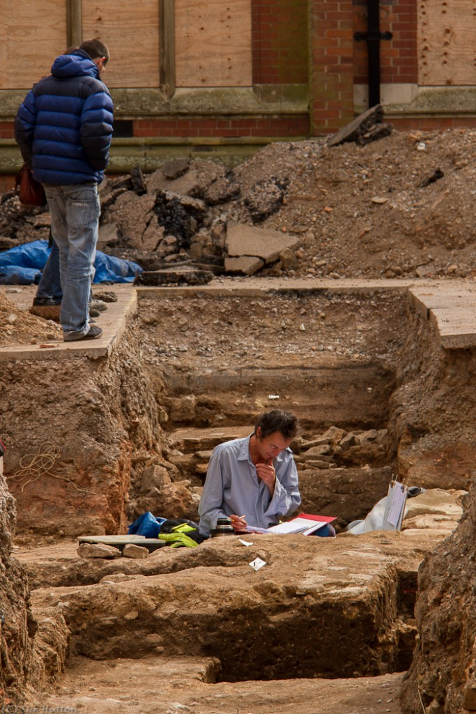 http://commons.wikimedia.org/wiki/File:Archaeologist_working_in_Trench.jpg