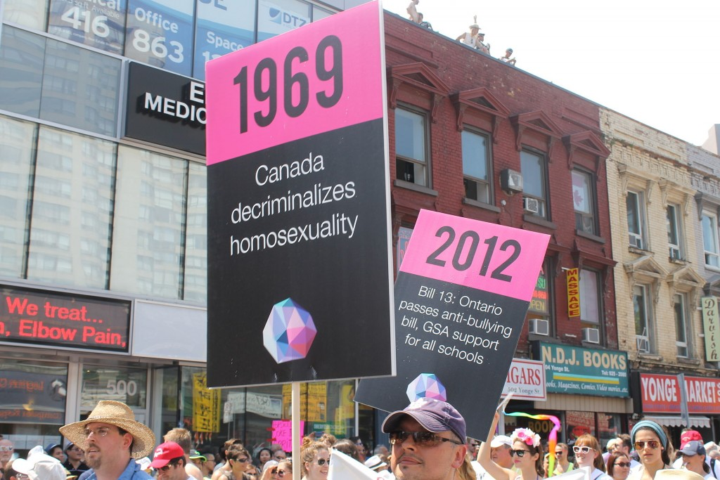 http://commons.wikimedia.org/wiki/Category:LGBT_history_in_Canada#/media/File:Marchers_at_Toronto_Pride_2014.jpg