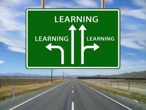 """A highway sign with forward, left, and right arrows, all pointing to """"learning."""""""