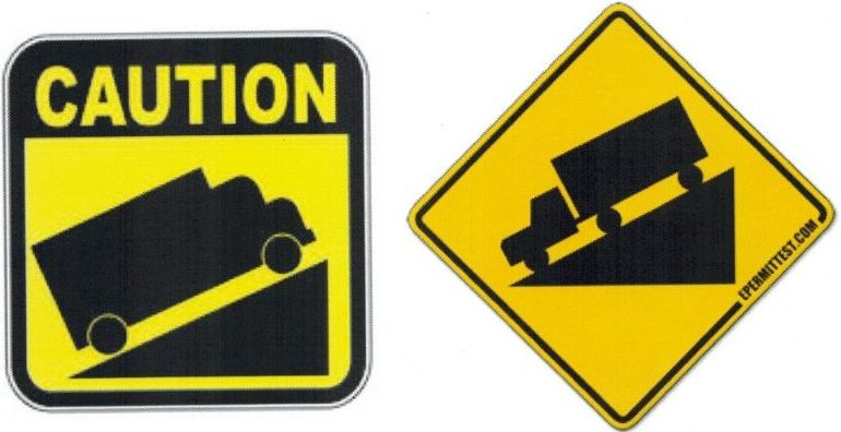 Caution signs for steep upward and downward slopes.