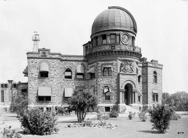Observatory with a stone facade and a dome on the top.