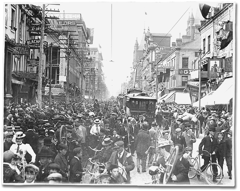 A city street crowded with people.