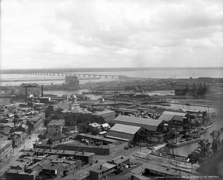 Montreal docks. Working-class housing is visible in the foreground.