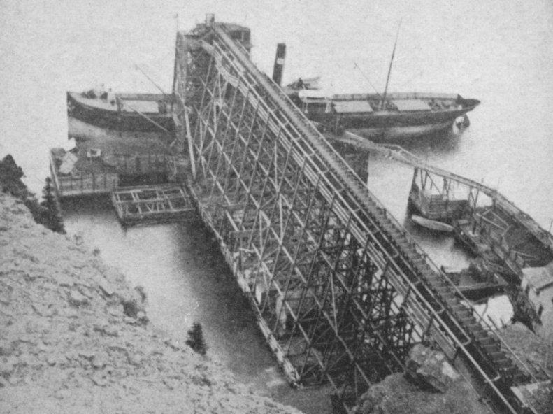 Conveyor belt buit on scaffolding at dock.
