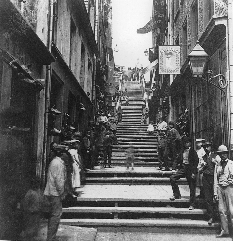 Upward view of very steep steps in a city.