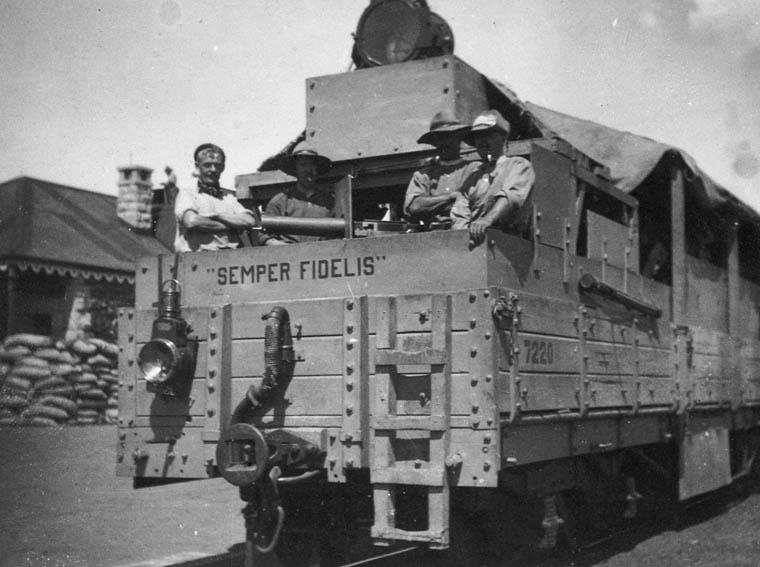"""Canadian troops stand in a military truck that says """"Semper fidelis,"""" or """"Always faithful."""""""