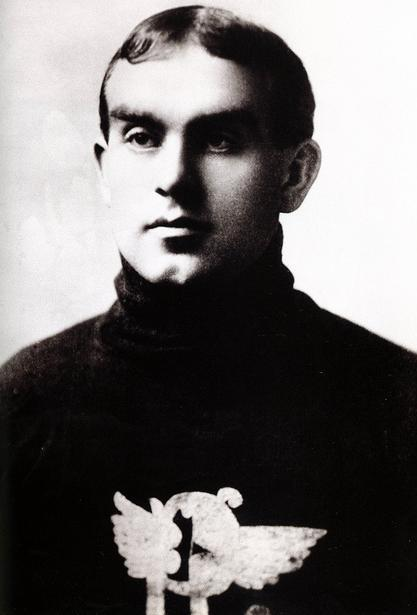 A photo portrait of a young man in a hockey sweater.