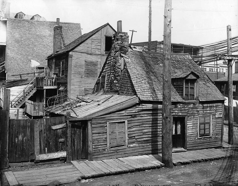 Simple wooden houses built close together.