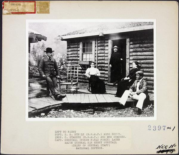 People on a cabin porch. Long description available.