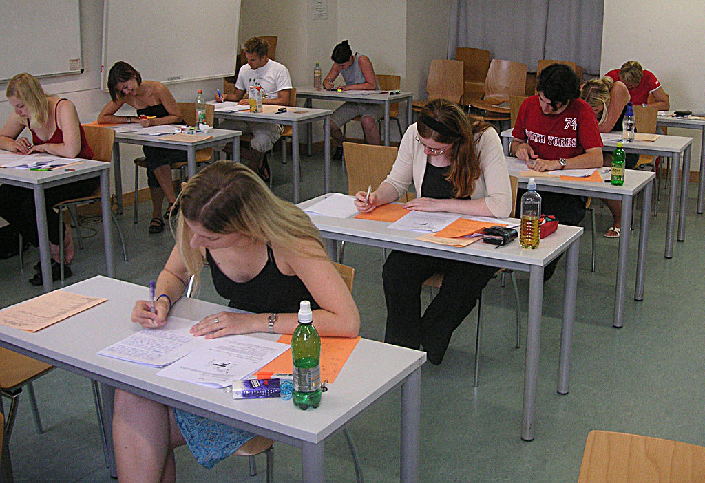 A classroom of students sitting at desks taking a test