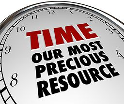 """A clock face that reads, """"Time, our most precious resource"""""""