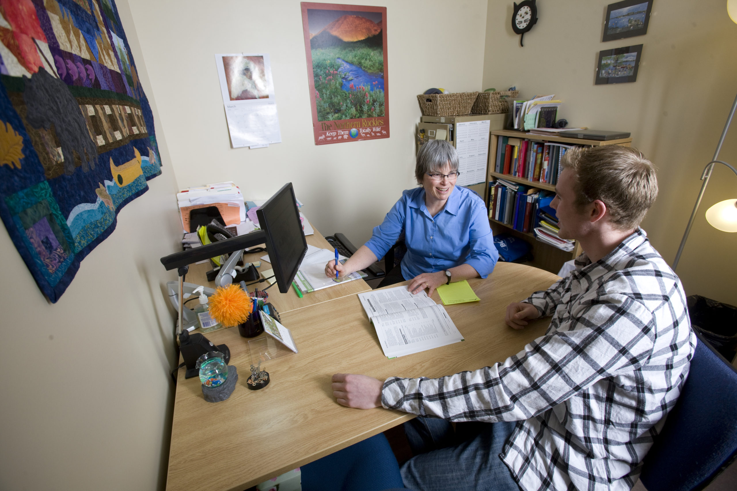 An education advisor at College of the Rockies works with a student