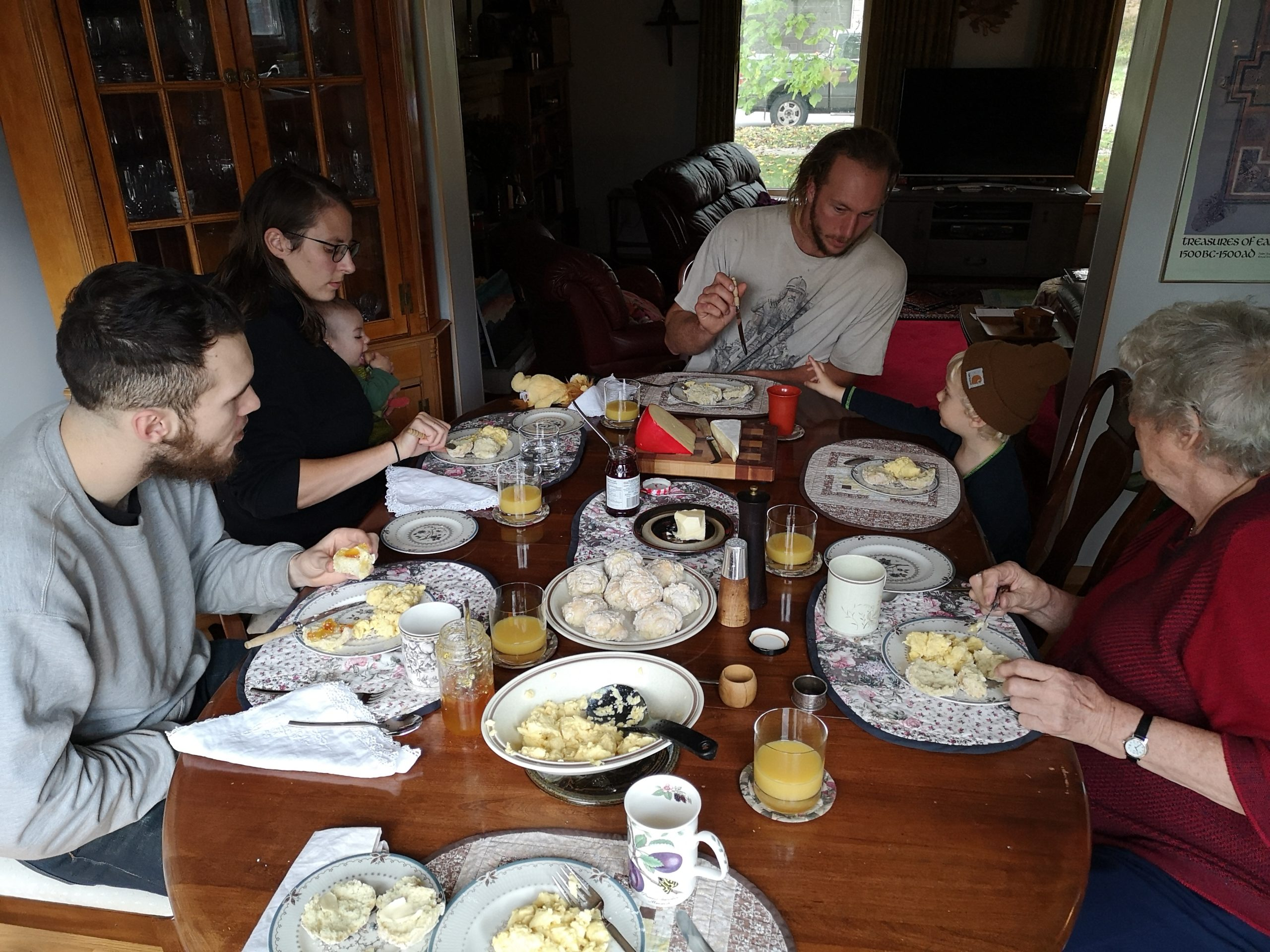 A family sitting around the dinner table eating breakfast