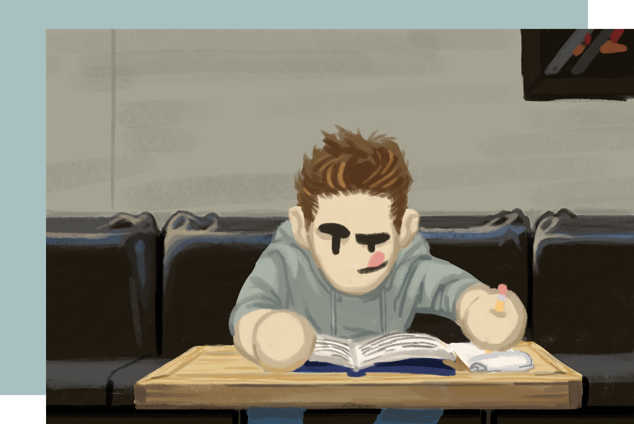 Guy on couch with book taking notes
