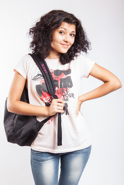 A college student poses with a backpack