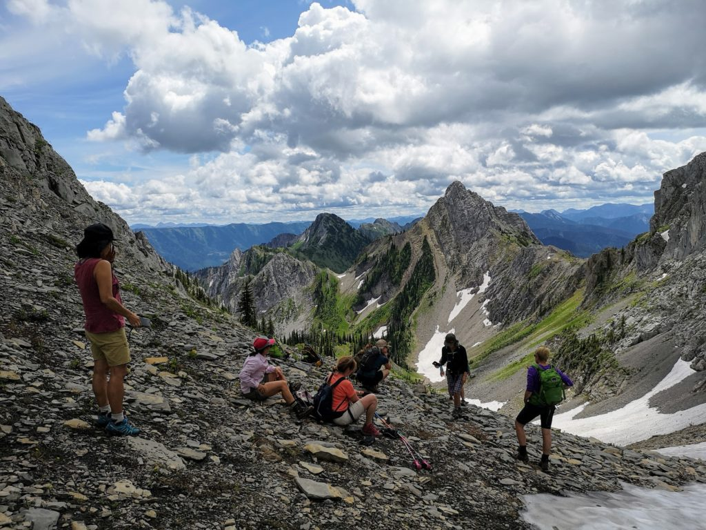A group of people hiking in the mountains