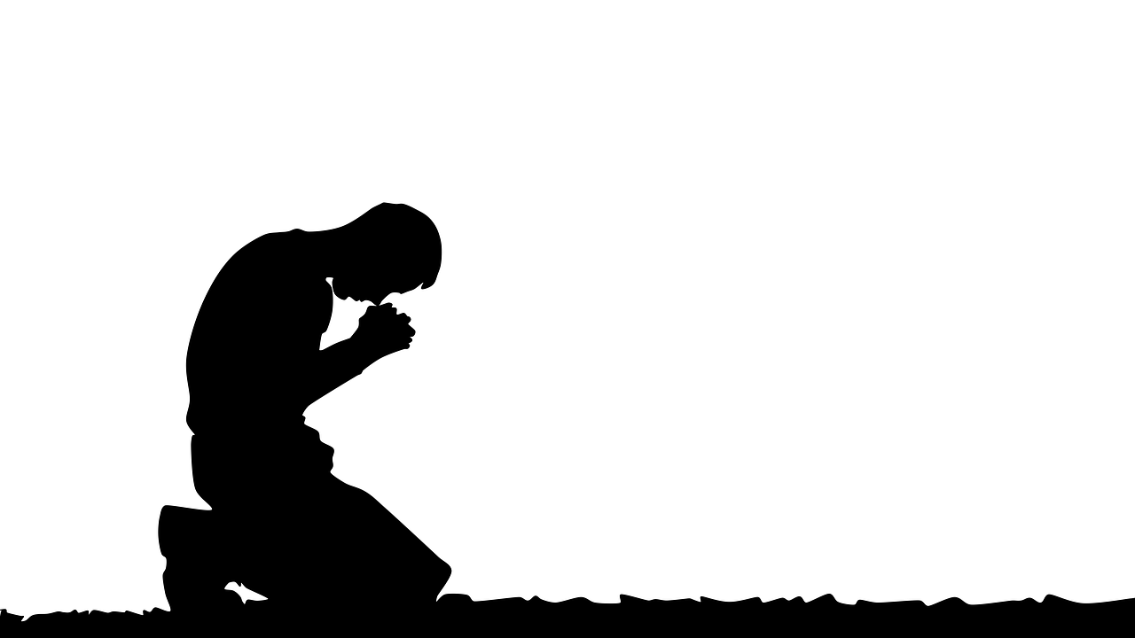 A person on their knees praying