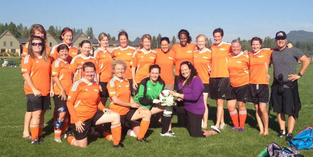 A woman's soccer team posing for a picture