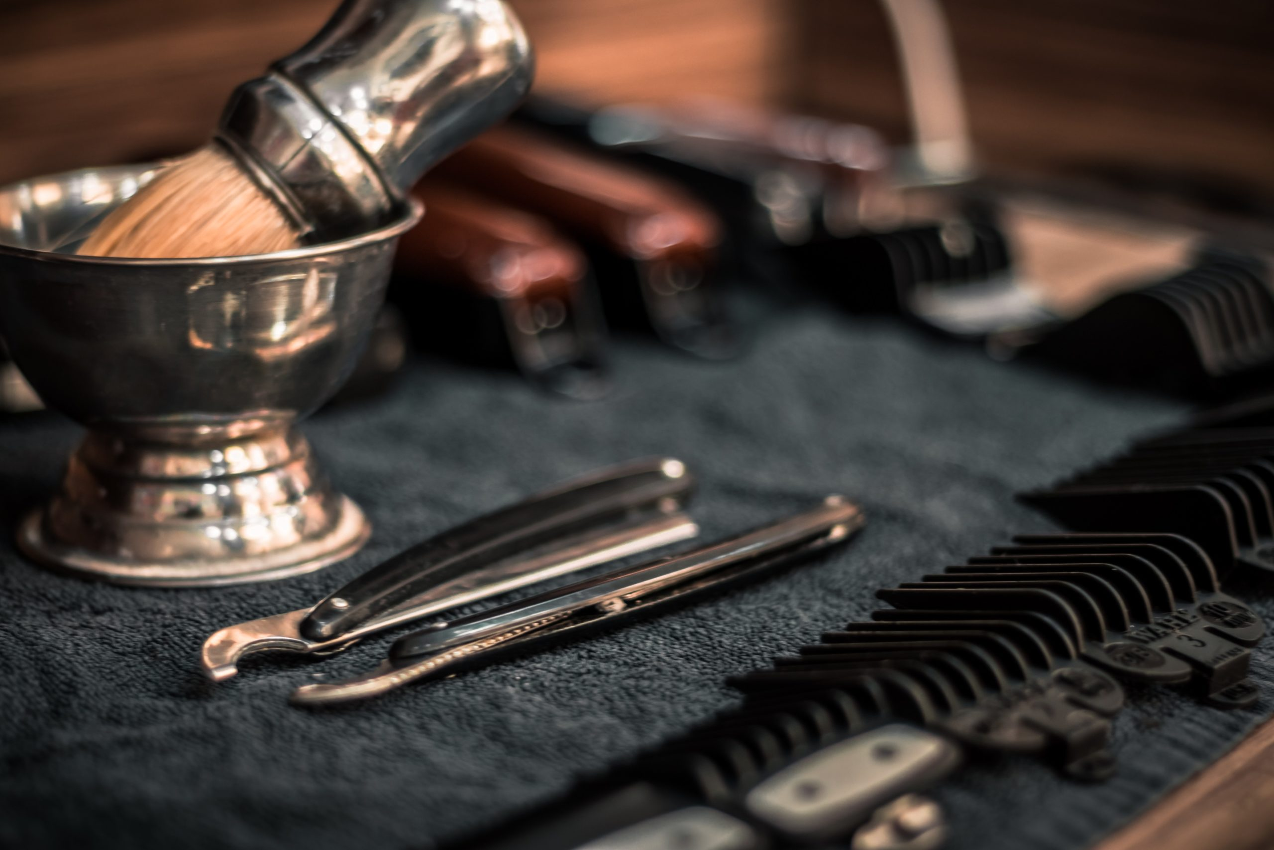Barbering tools laid out on a towel.