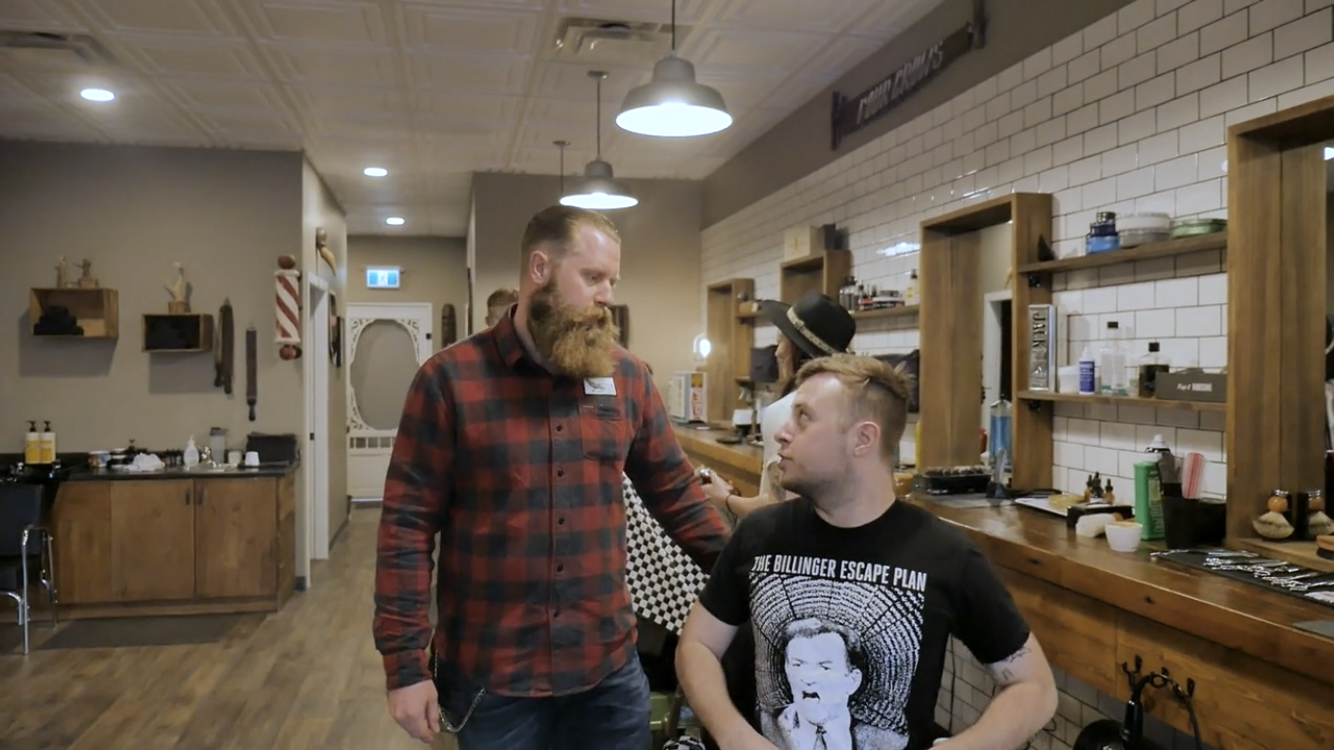 A barber consulting with a client.