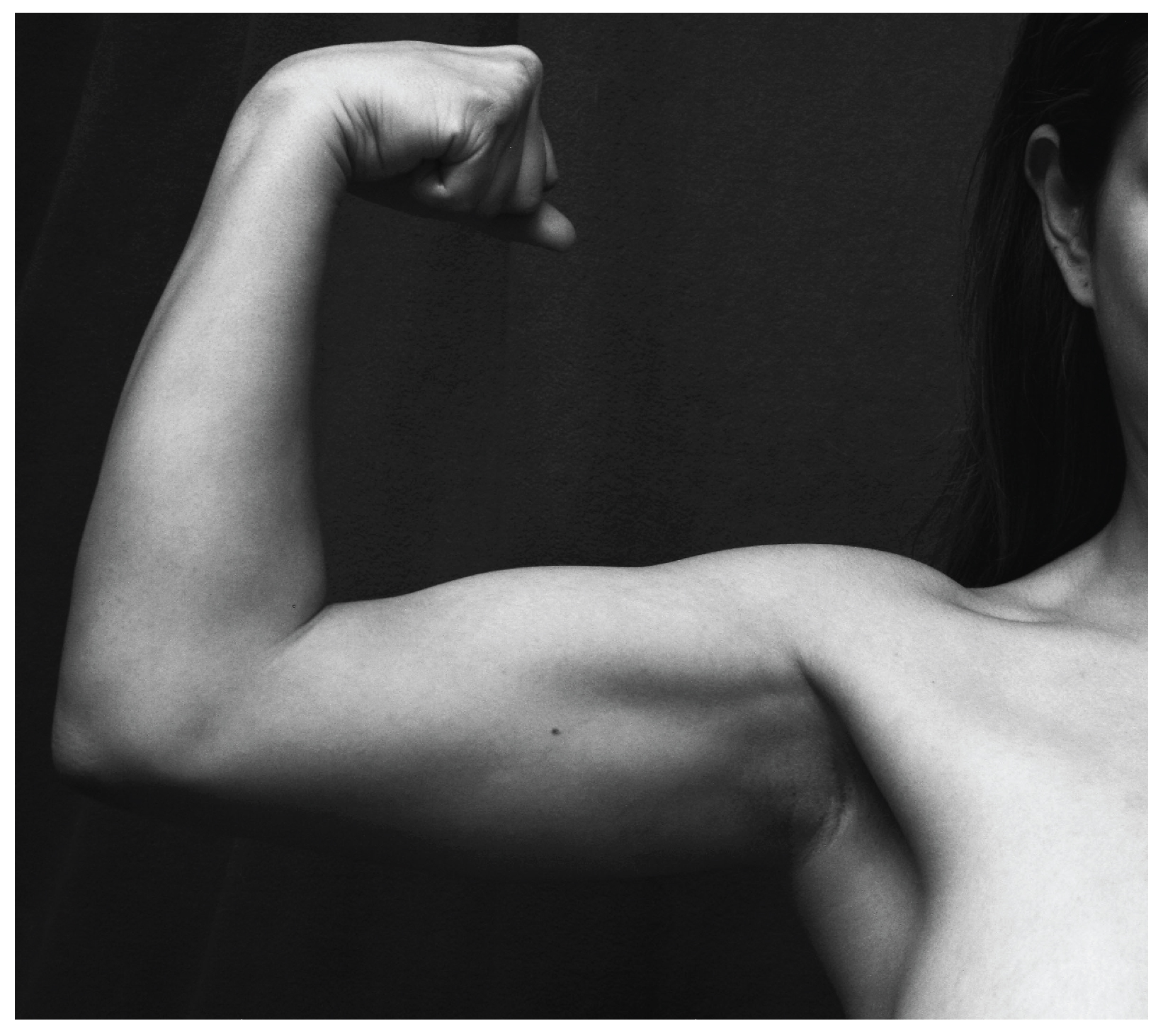 This photo shows a person flexing her biceps.