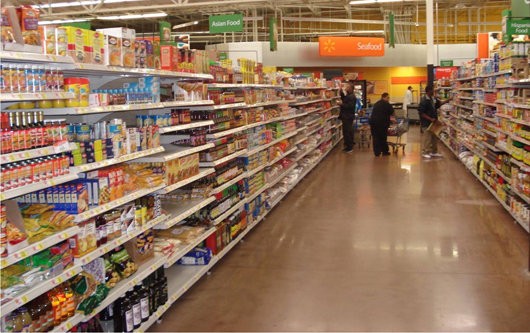 A photo shows people shopping in a grocery store.