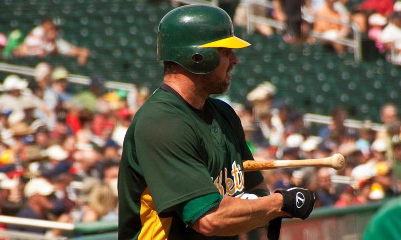 Photo shows baseball player Jason Giambi at a game.