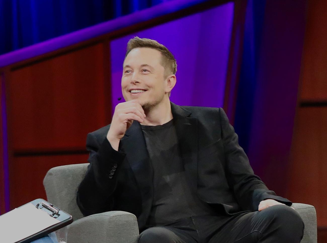 A photograph shows Elon Musk.