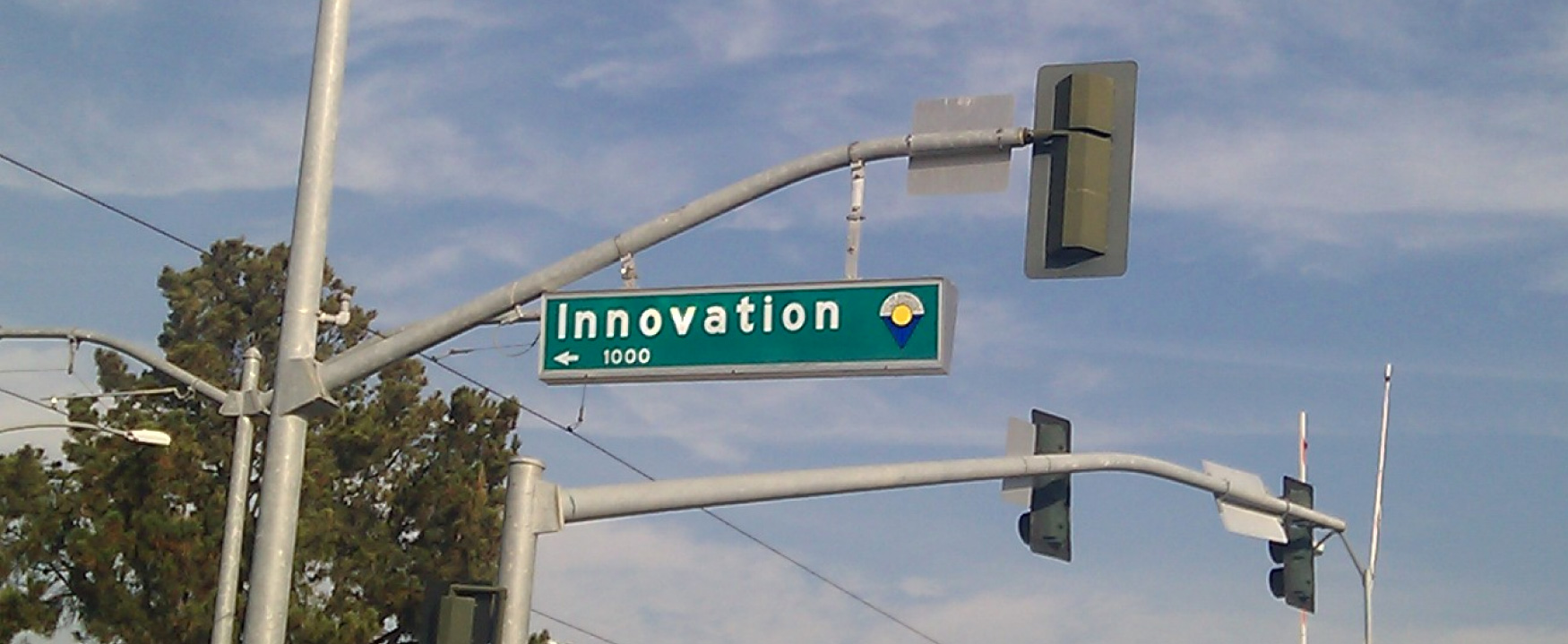 A photograph shows a street sign, and the street is named Innovation