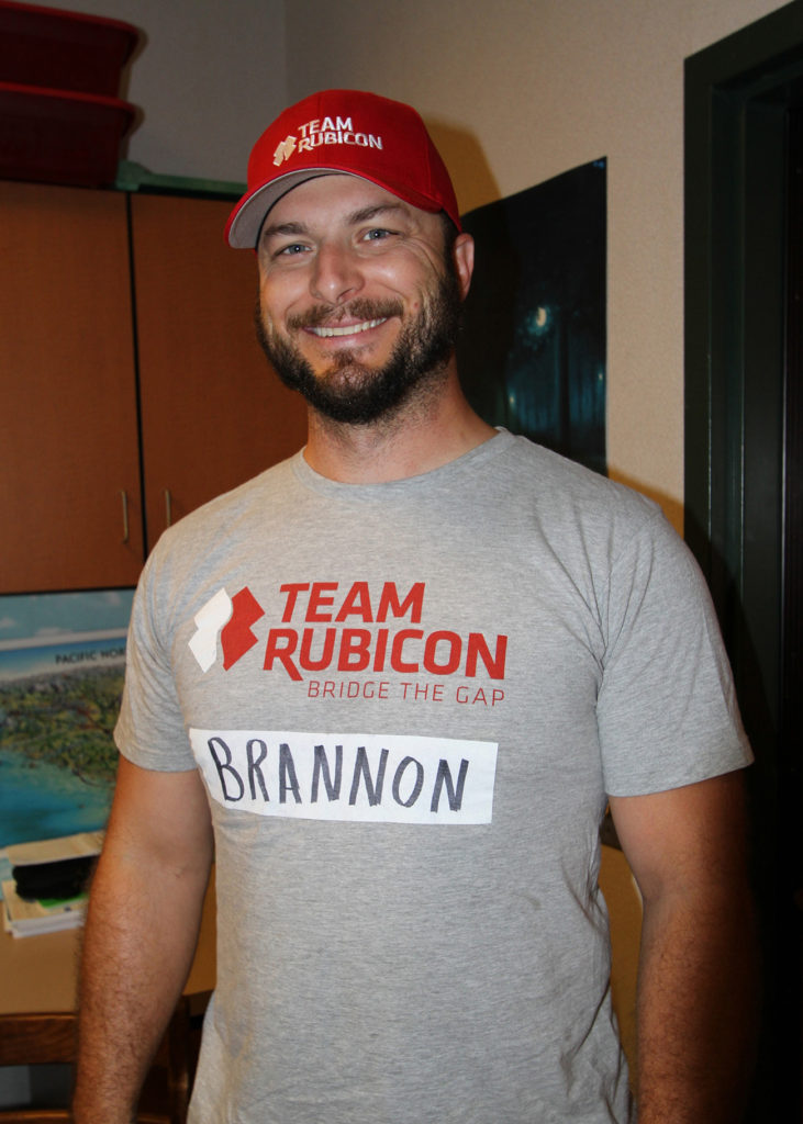 A man wearing a Team Rubicon hat and shirt.