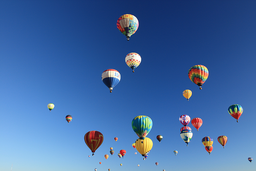A picture of many hot air balloons.