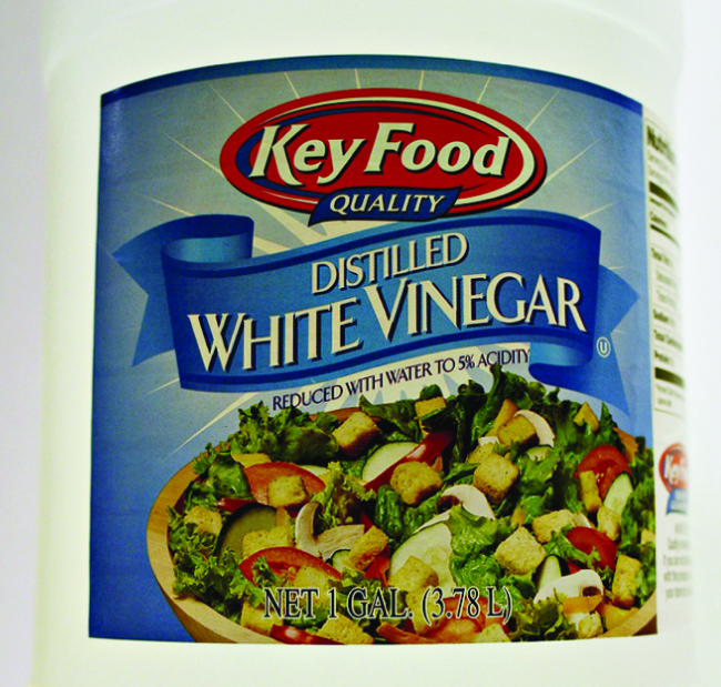 An image shows the label of a bottle of distilled white vinegar. The label states that the contents have been reduced with water to 5 percent acidity.