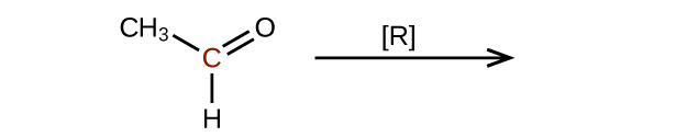 The left side of a reaction and arrow are shown. The arrow is labeled with an R in brackets. To the left of the arrow is a molecular structure that shows a central, red C atom. This C atom is bonded to a C H subscript 3 group, and H atom, and an O atom. It forms a double bond with the O atom.