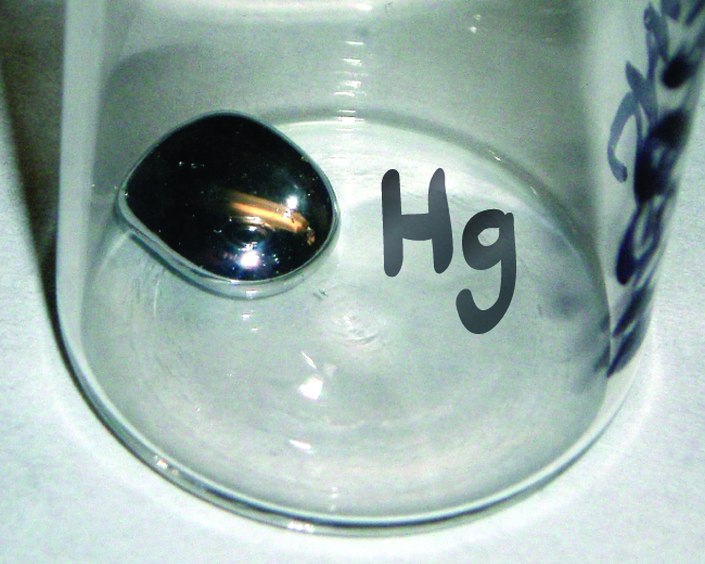 """A jar labeled """"H g"""" is shown with a small amount of liquid mercury in it."""