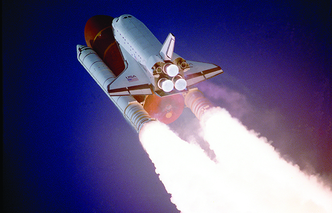 A rocket is shown taking off.