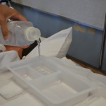 Pour sterile cleansing solution into sterile tray