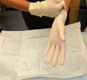Pull glove up to wrist