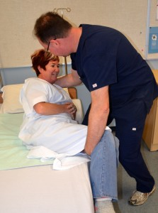 Assisting patient into a sitting position