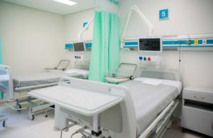 A hospital room with two beds.
