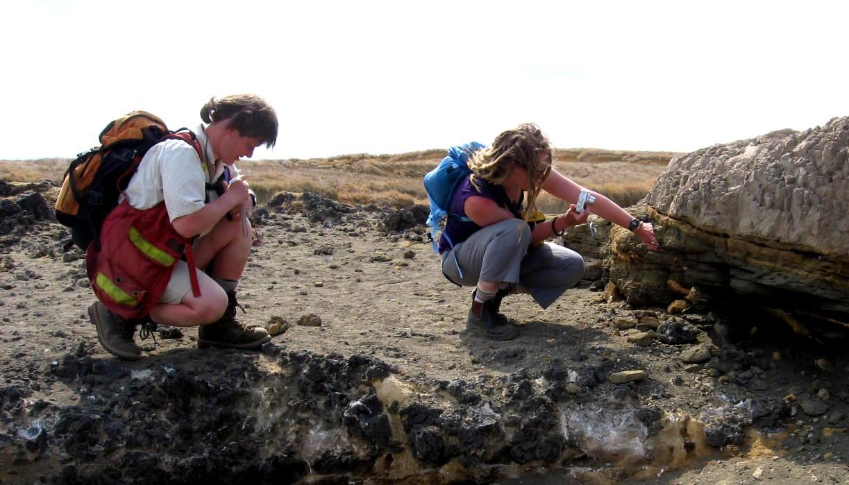 Geologists examining ash-layer deposits at Kilauea Volcano, Hawaii [SE photo]