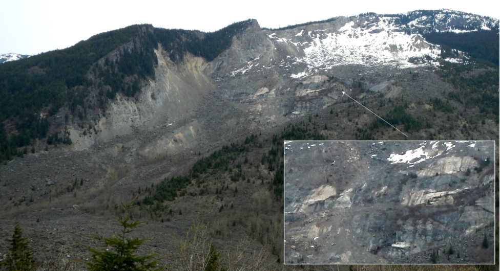 Photograph of the site of the 1965 Hope Slide as seen in 2014. The initial failure is thought to have taken place along the foliation planes and sill within the area shown in the inset. [SE]