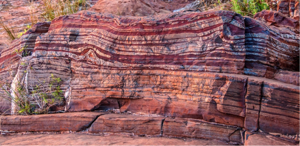 Figure 6.14 Banded iron formation (red) interbedded with chert (white), Dales Gorge, Australia [By Dales Goge by Graeme Churchard under CC BY 2.0.