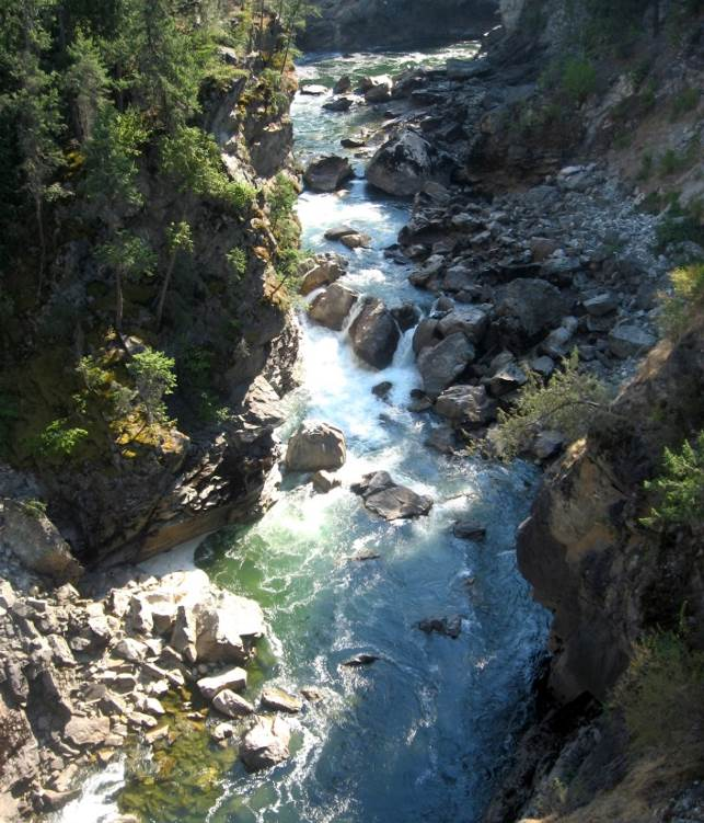Figure 13.18 The Cascade Falls area of the Kettle River, near Christina Lake, B.C. This stream has a step-pool morphology and a deep bedrock channel. [SE]