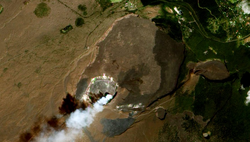 Aerial view of the Kilauea caldera. The caldera is about 4 km across, and up to 120 m deep. It encloses a smaller and deeper crater known as Halema'uma'u.