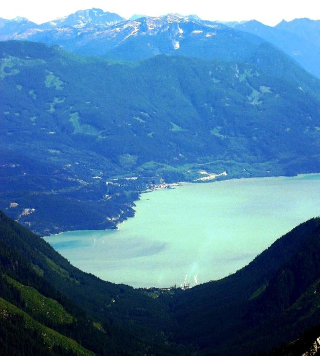 Figure 16.21 The view down the U-shaped valley of Mill Creek valley toward the U-shaped valley of Howe Sound, with the village of Britannia on the opposite side. [http://commons.wikimedia.org/wiki/File:Woodf1a.jpg]