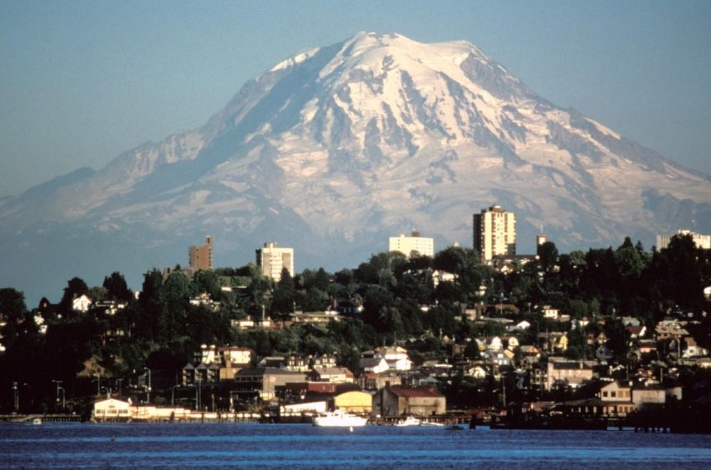 Figure 15.20 Mount Rainier, Washington, from Tacoma. [By Lynn Topinka, US Geological Survey, http://en.wikipedia.org/wiki/Mount_ Rainier#/media/File:Mount_Rainier_over_Tacoma.jpg]