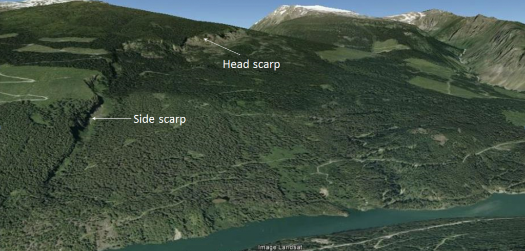 Figure 15.9 The Downie Slide, a sackung, on the shore of the Revelstoke Reservoir (above the Revelstoke Dam). The head scarp is visible at the top and a side-scarp along the left side. [from Google Earth]
