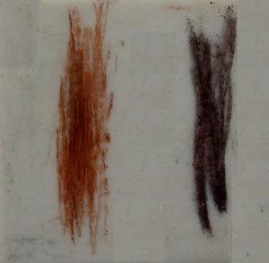 Figure 2.17 The streak colours of earthy hematite (left) and specular hematite (right). Although the specular hematite streak looks close to black, it does have red undertones that you can see if you look closely. [SE]